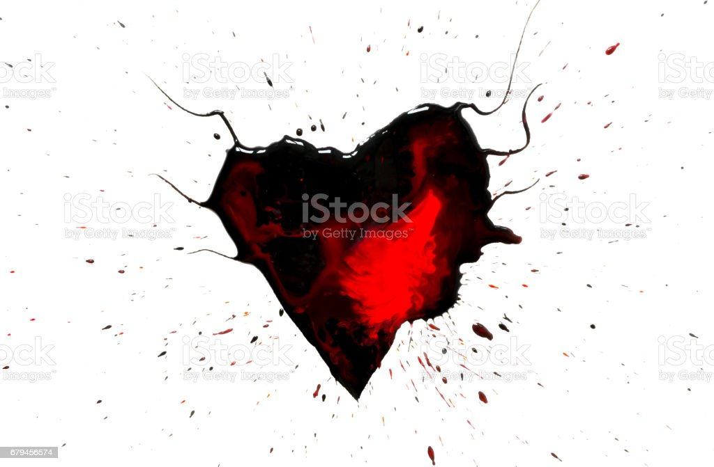 Black heart with horns with red drops and stains and black paint spray around isolated on white background. royalty-free stock photo
