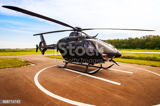 Black helicopter on the helipad