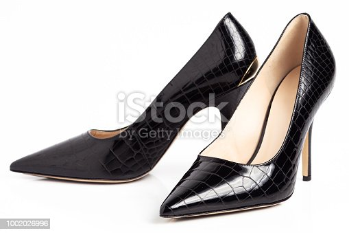 Black high heel shoes isolated on a white background.