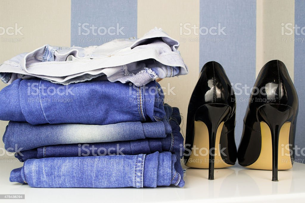 Black high heel shoe for woman and jeans stock photo