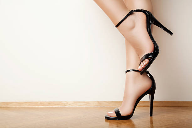 black high heels - human foot stock photos and pictures