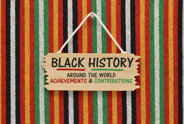 Black History Black History Around the World Achievements & Contributions wood sign hand on striped background black history month stock pictures, royalty-free photos & images