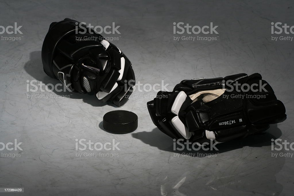 Black hockey equipment laying on an ice rink royalty-free stock photo