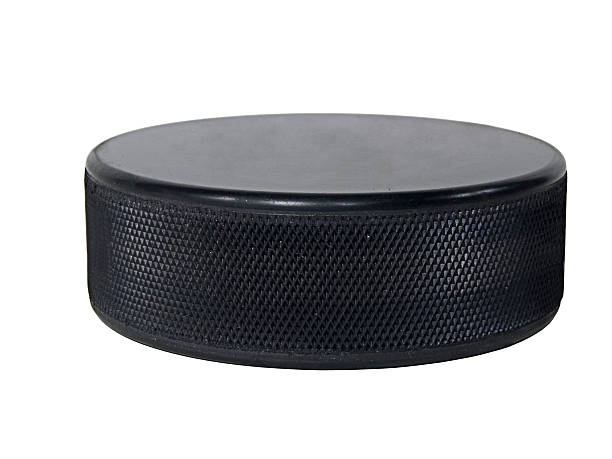 black hockey puck isolated on white - hockey puck stock photos and pictures