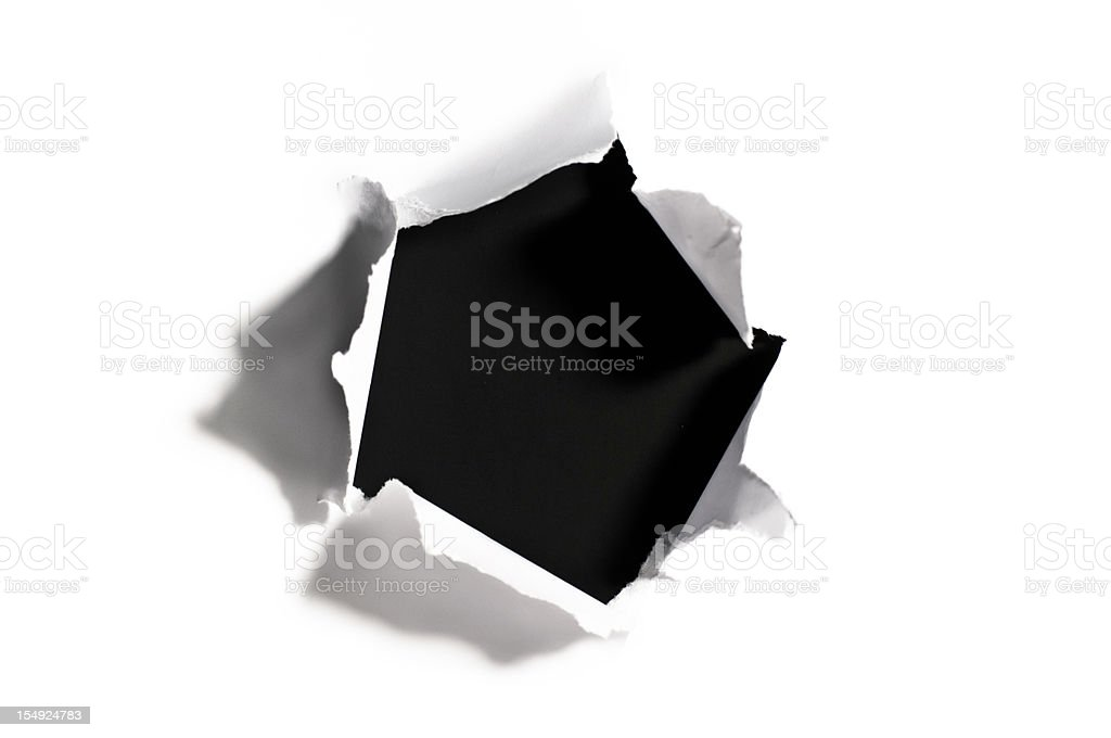 Black hole in torn white paper stock photo