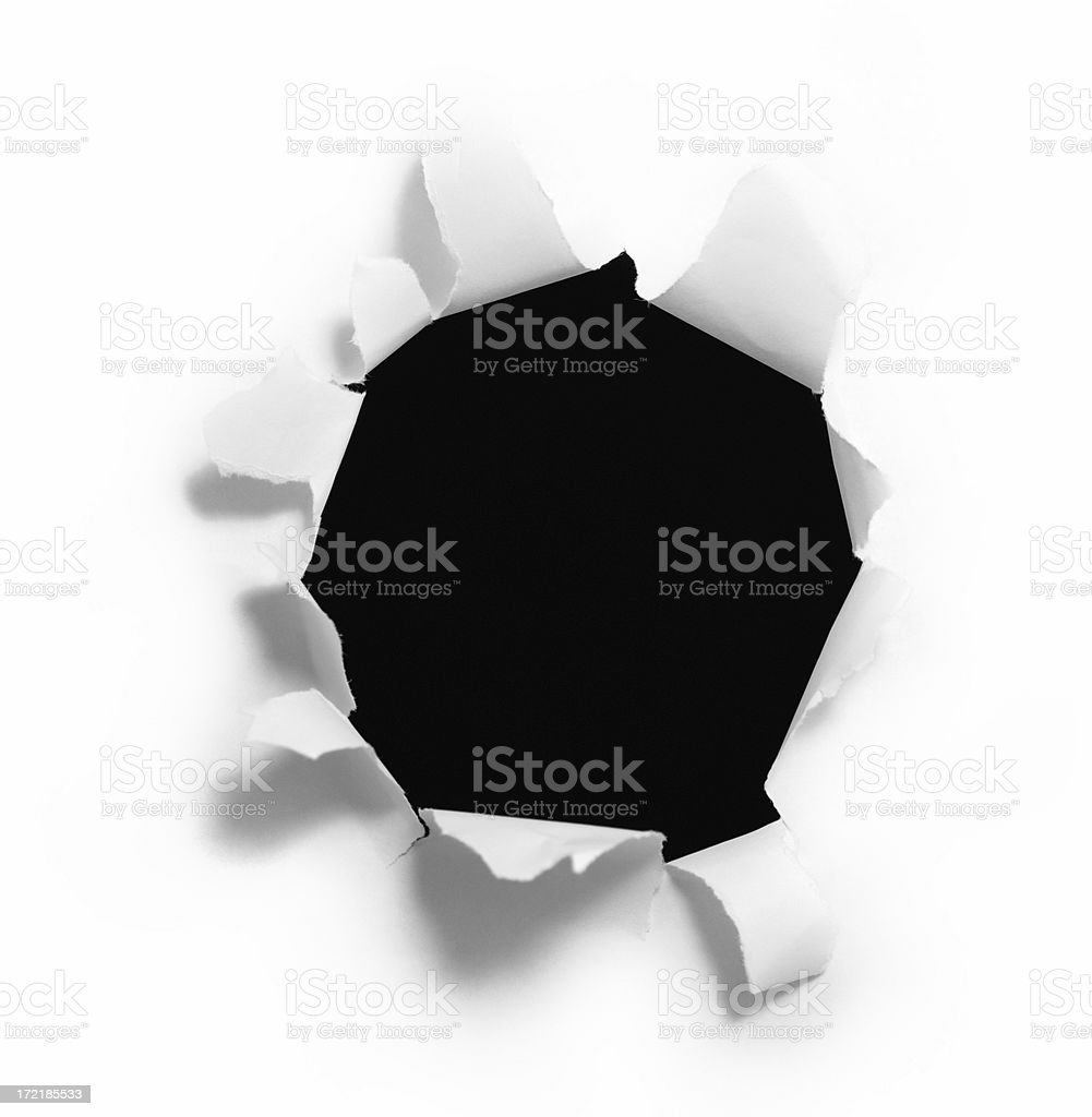 Black Hole Ripped Into a Piece of Paper stock photo