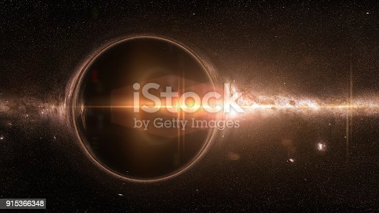 istock black hole with gravitational lens effect and the Milky Way galaxy 915366348