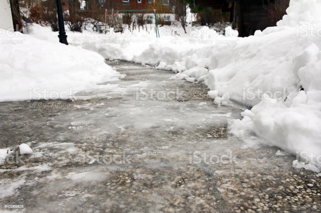 Black ice on a walkway stock photo