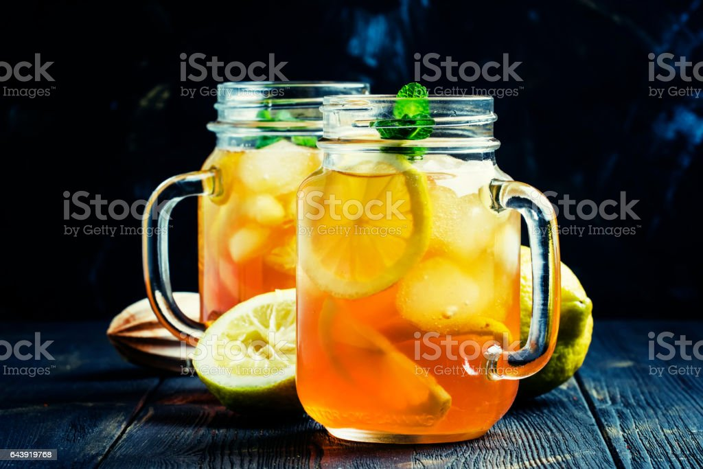Black ice tea with lemon in a glass jar - Photo
