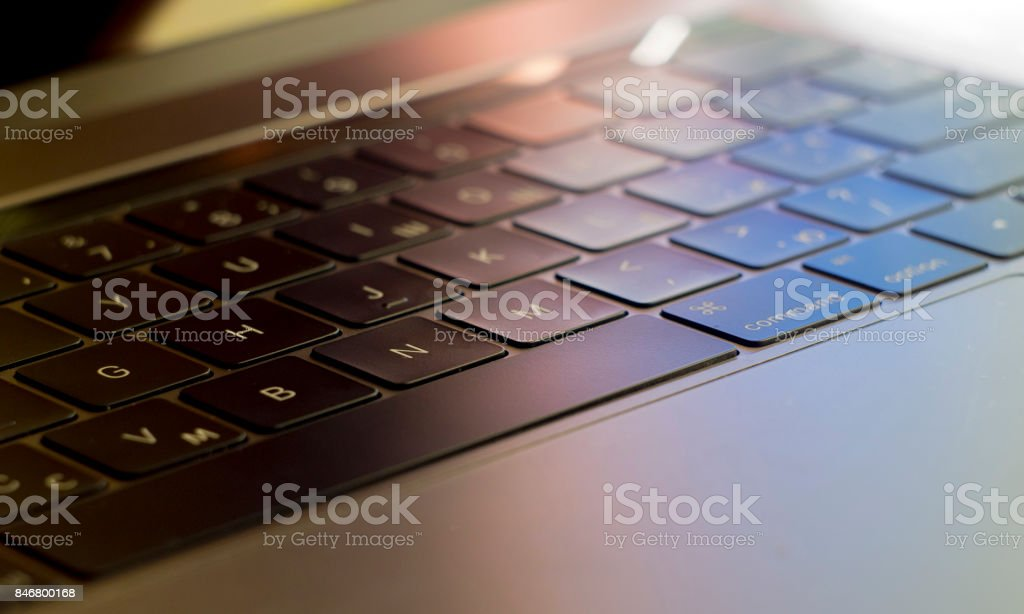 black illuminated laptop keyboard stock photo