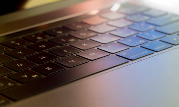 black illuminated laptop keyboard stock photo