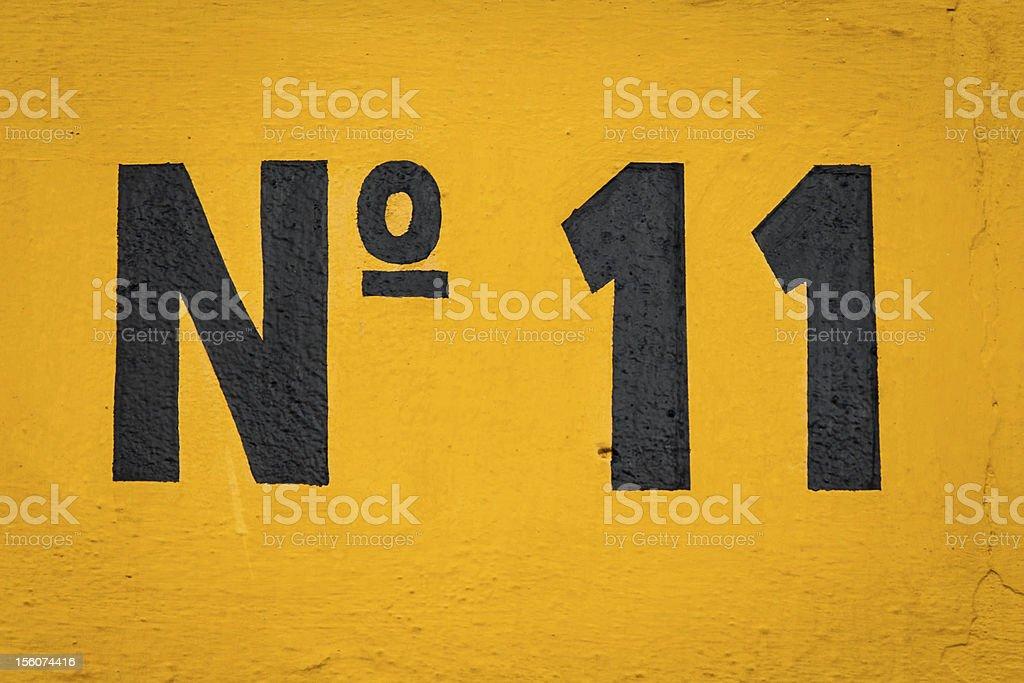 Black image of the number 11 on orange background royalty-free stock photo