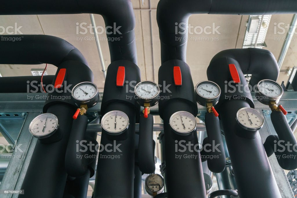 Black industrial pipes and equipment stock photo