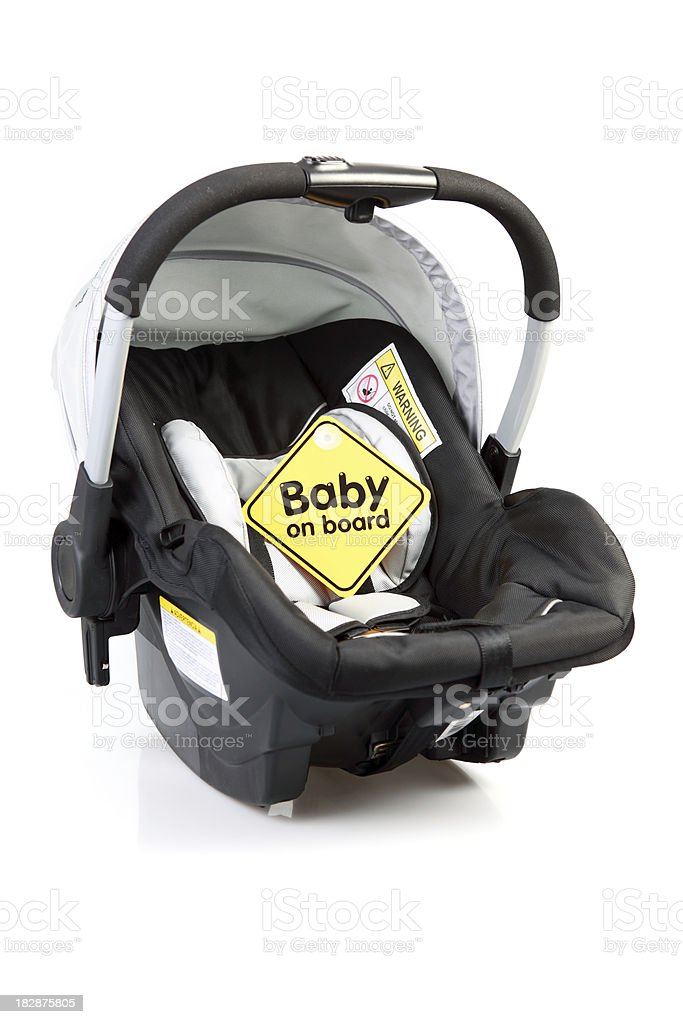 Black infant car seat with yellow alert baby on board  stock photo
