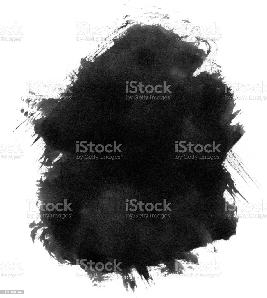 Black ink blot splattered on a white background stock photo