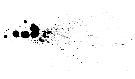 Black ink drops on white background.