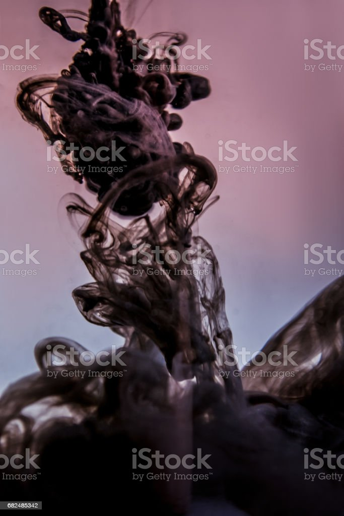 black ink in water isolated on white background Стоковые фото Стоковая фотография