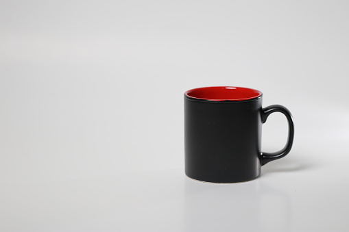 black inside red coffee cup on white isolated background