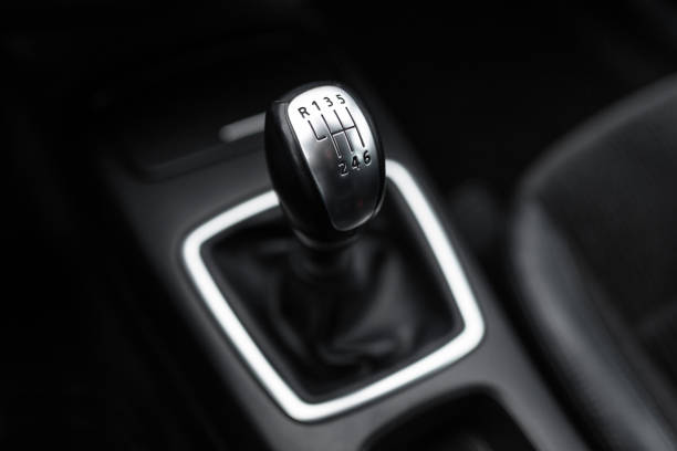 Black interior of a modern car, six-speed manual shift car gear lever. Black interior of a modern car, six-speed manual shift car gear lever. gearshift stock pictures, royalty-free photos & images