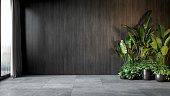 istock Black interior with wood wall panel and plants. 3d render illustration mock up. 1272362475