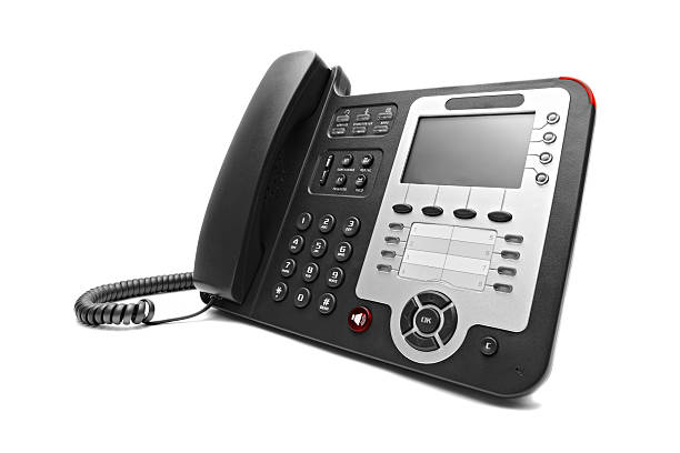 Black IP office phone isolated stock photo
