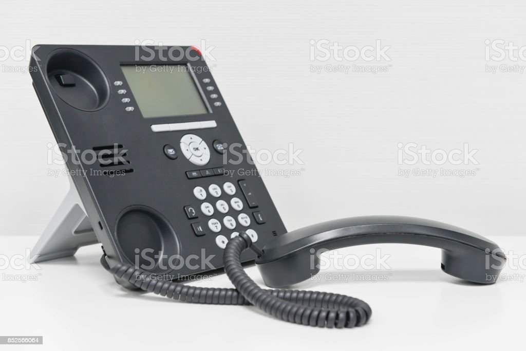 Black IP Phone and handset on the white table stock photo
