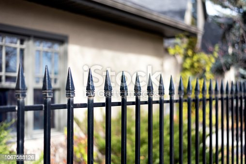 Black iron fence closeup