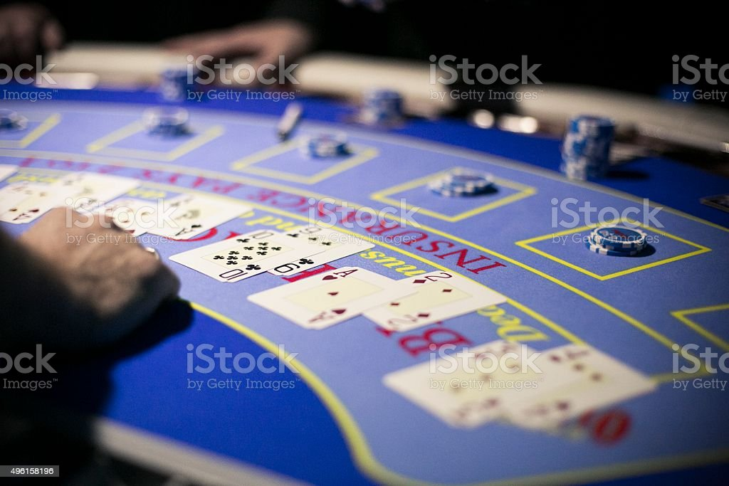 Black jack tokens and playing cards on the table stock photo