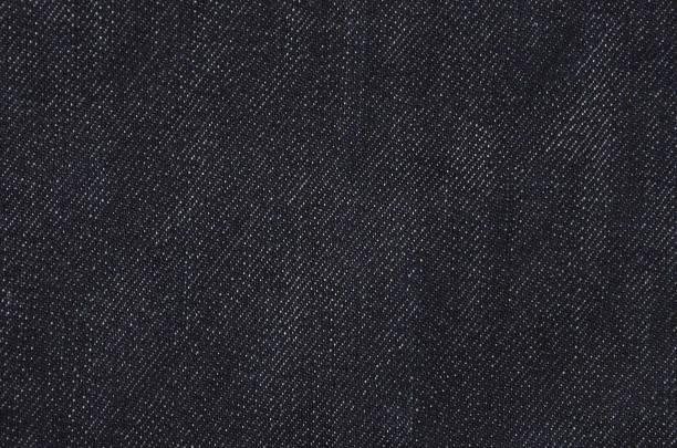zwarte jeans achtergrond - zwarte spijkerbroek stockfoto's en -beelden