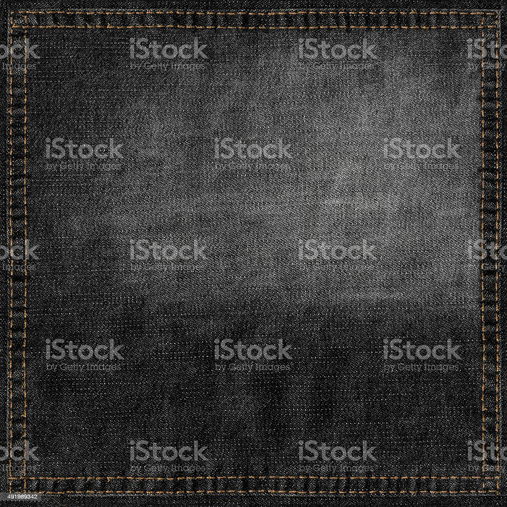 Black jeans grunge background with stitched frame stock photo