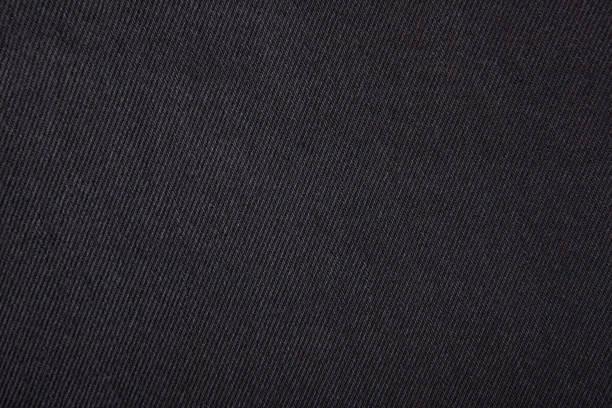 black jeans textur. - textilien stock-fotos und bilder