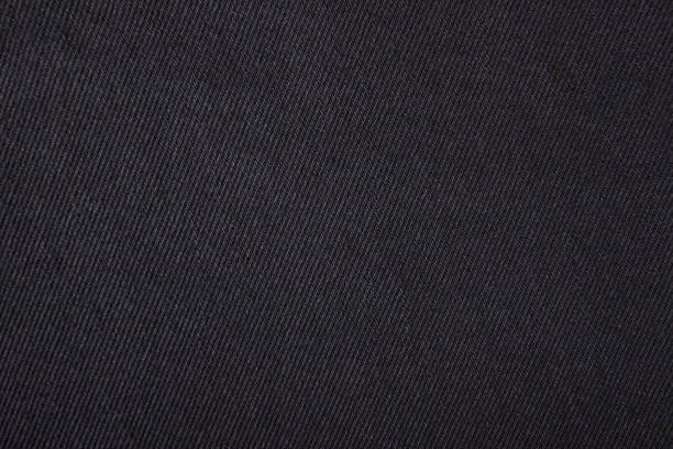 zwarte jeans textuur. - textiel stockfoto's en -beelden
