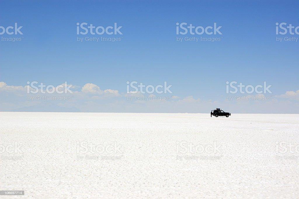 Black  jeep in salt desert Salar de Uyuni stock photo