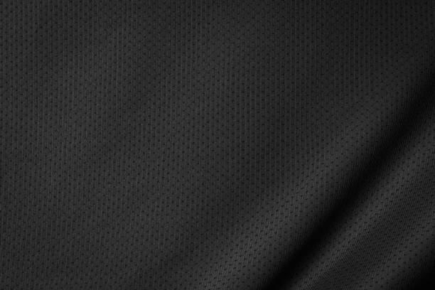 schwarzes jersey textur hintergrund. detail der luxuriösen stoffoberfläche. - textilien stock-fotos und bilder