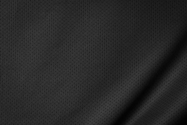 Black jersey texture background. Detail of luxury fabric surface. Black jersey texture background. Detail of luxury fabric surface. basketball sport stock pictures, royalty-free photos & images