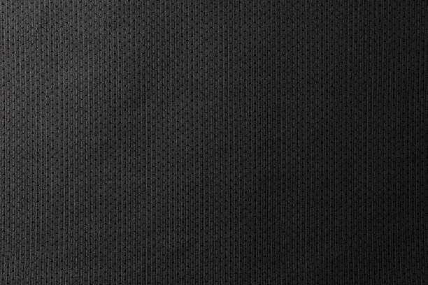 Black jersey texture background. Detail of luxury fabric surface. stock photo
