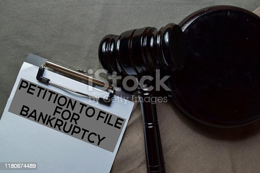 612372074istockphoto Black Judges gavel and Petition to File For Bankruptcy Document form on office desk. Law concept 1180674489