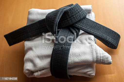 istock Black judo, aikido, or karate belt, tied in a knot 1182184205