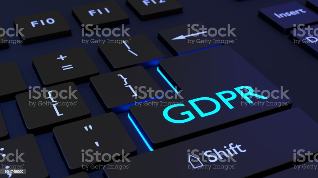 Black keyboard with blue glowing enter key with the letters DGPR royalty-free stock photo