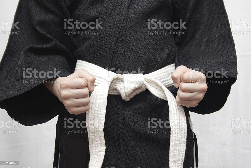 Black kimono and a white belt. royalty-free stock photo