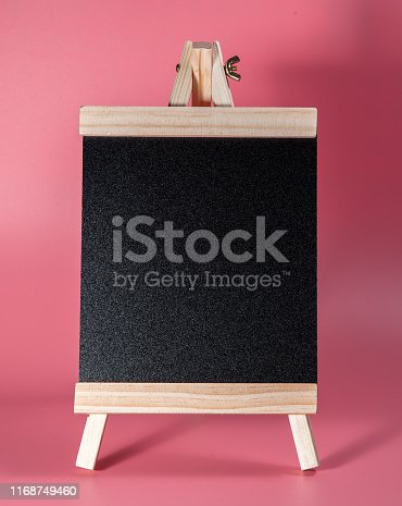 997496254 istock photo Black label chalkboard on the table Pink background. Stand for acrylic tent card Used for Menu Bar and restaurant or put everything into it . mockup 1168749460