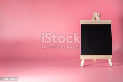 997496254 istock photo Black label chalkboard on the table Pink background. Stand for acrylic tent card Used for Menu Bar and restaurant or put everything into it . mockup 1168749625