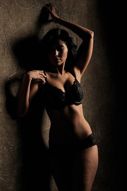 Black Lace Lingerie in Shadows stock photo