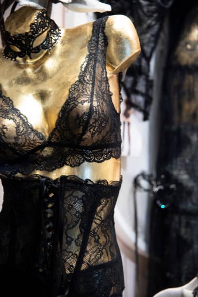 Black lace lingerie on gold mannequin. stock photo