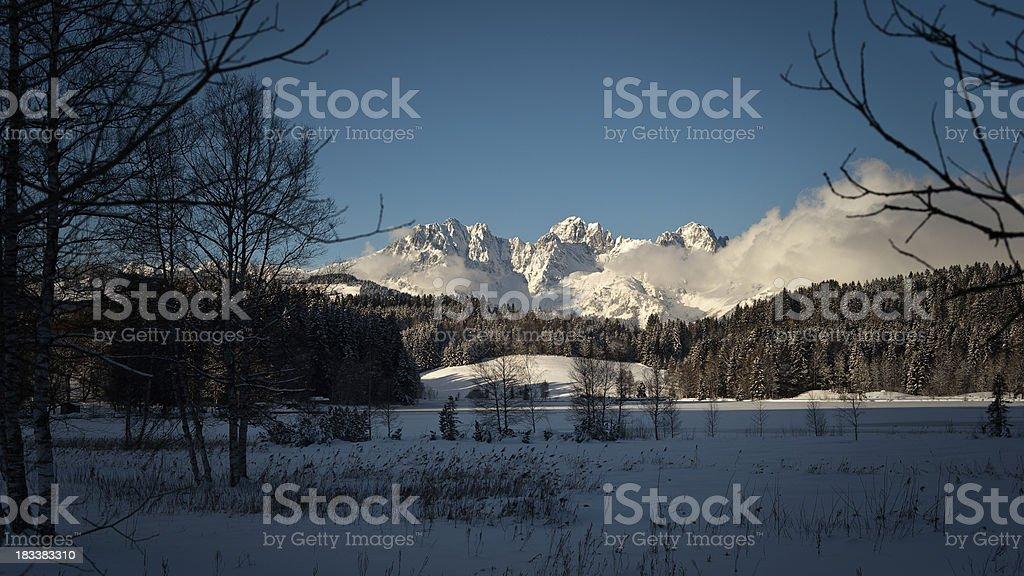 Black Lake Kitzbühel with Wilder Kaiser stock photo