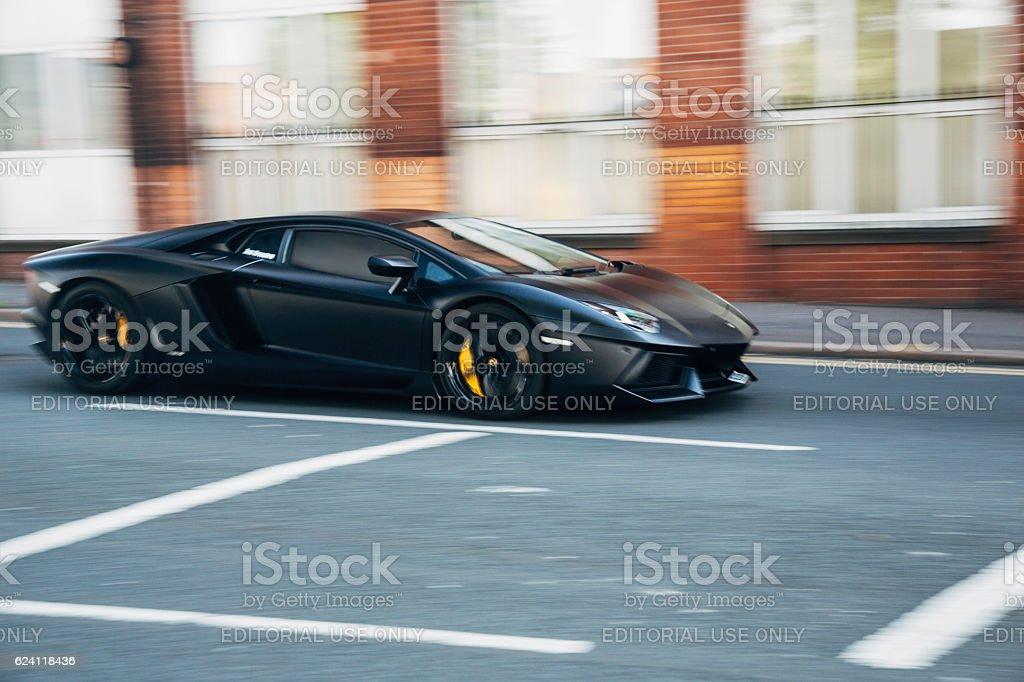 Black Lamborghini sports car in motion stock photo