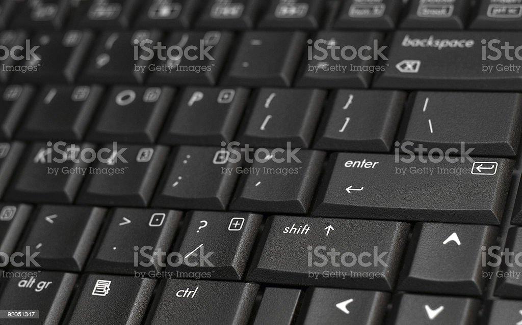 Black laptop keyboard closeup stock photo