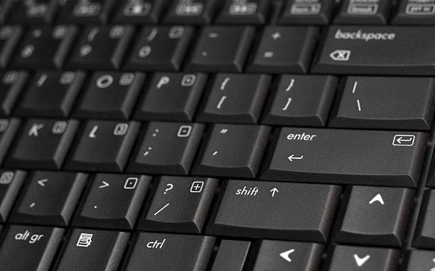Negro primer plano de teclado de la computadora portátil - foto de stock