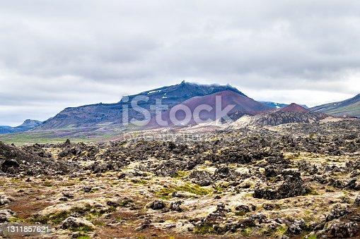 istock Black lava field on Snaefellsnes peninsula in Iceland with stones rocky field and nobody near Stykkish Stykkisholmur and Grundarfjordur cloudy sky 1311857621