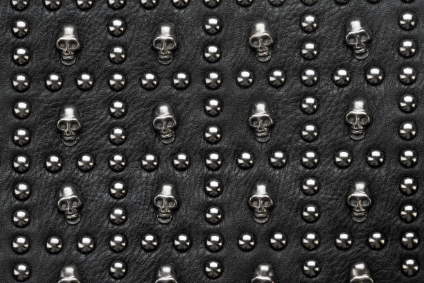 black leather abstract rock background with metal rivets stock photo